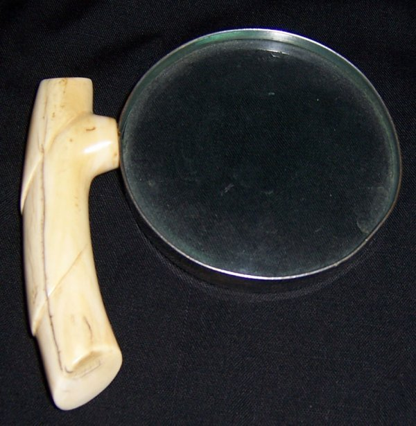 22: Ivory handle magnifying glass