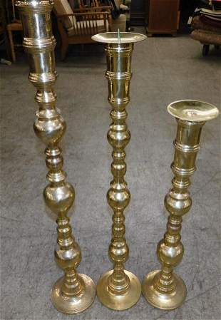 Three Large Brass Candlesticks