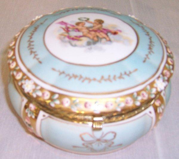 14: Hand painted cupid powder jar