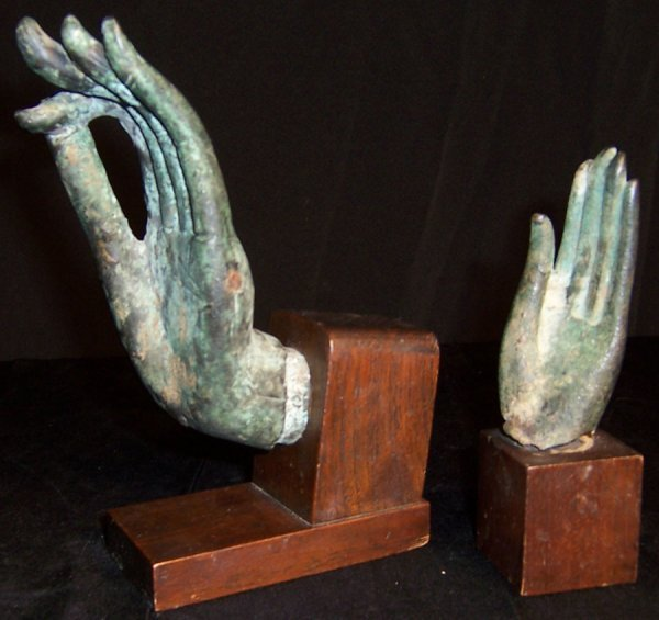 11: Two bronze mounted hands