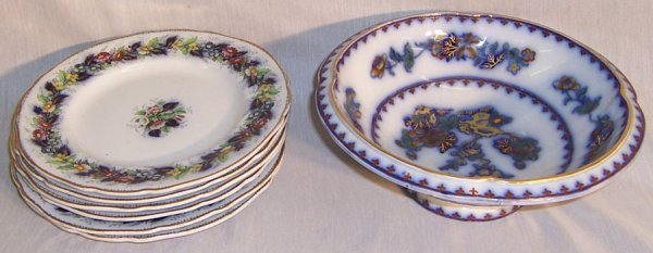 11: (6) Flow blue/gold décor. English plates and bowl