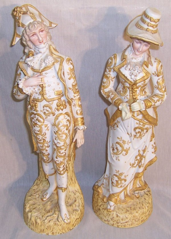 12: Pair of gold décor. Dresden type bisque figurines