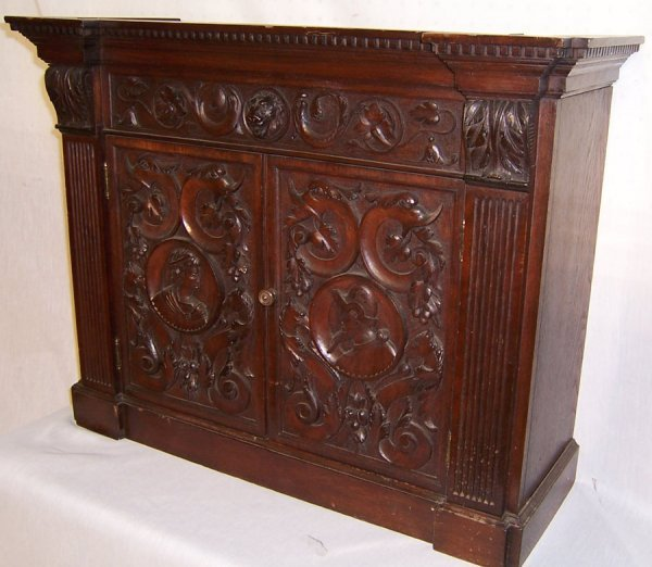 17: Carved walnut hanging cabinet, Circa 1850