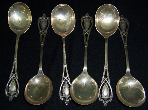 22: (6) Sterling cream soup spoons