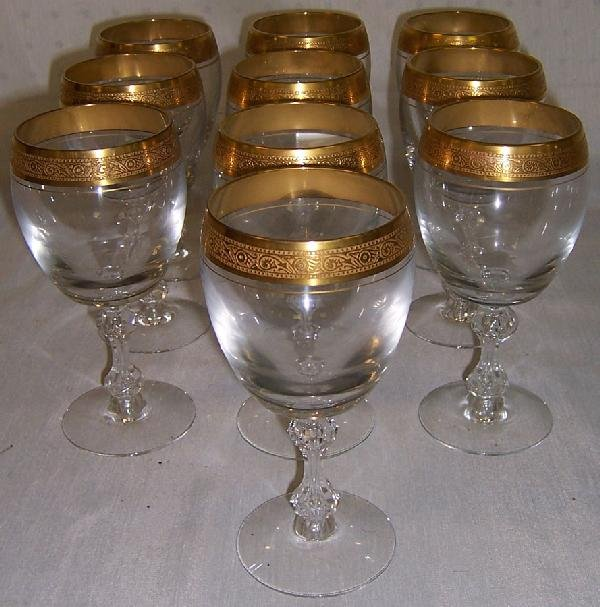 7: (10) open cut stem and gold decorated water goblets