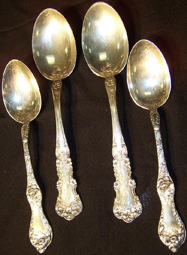 394: 4 table serving spoons