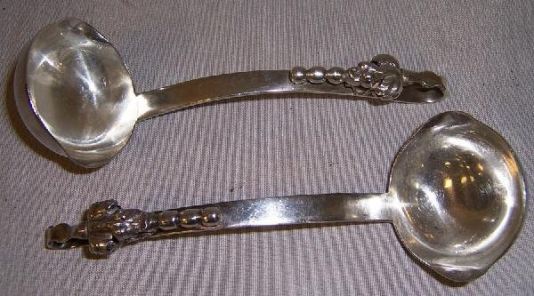 400: 2 sterling sauce ladles. Very heavy. Mexican maker