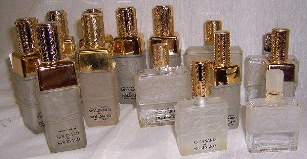 9: 14  Lalique perfume bottles.