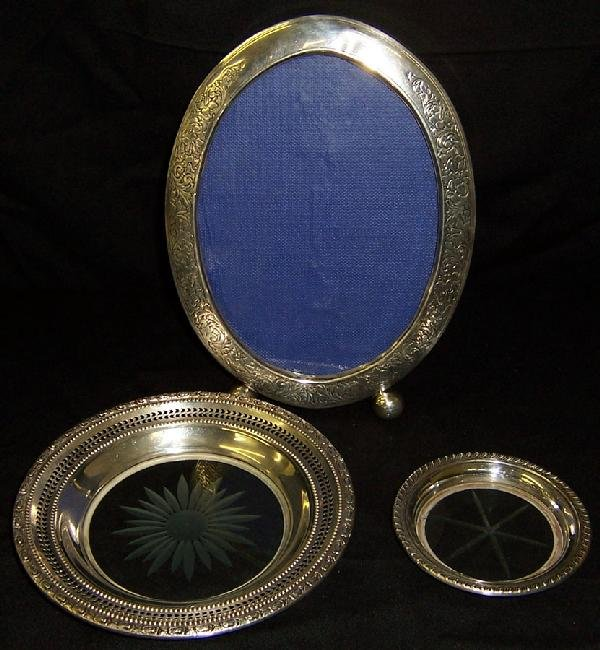 11: 2 sterling glass plates and sterling frame.
