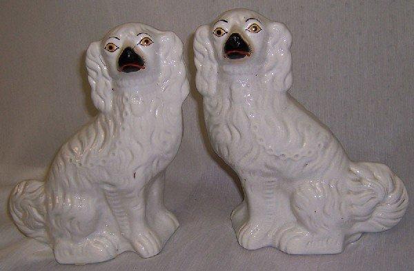 28: Pair of 19th century Staffordshire spaniels.