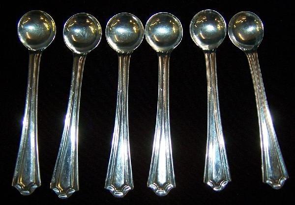 9: 6 sterling salt spoons.