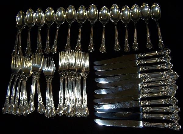 "49: 60 piece set ""Chantilly"" pattern sterling flatware."