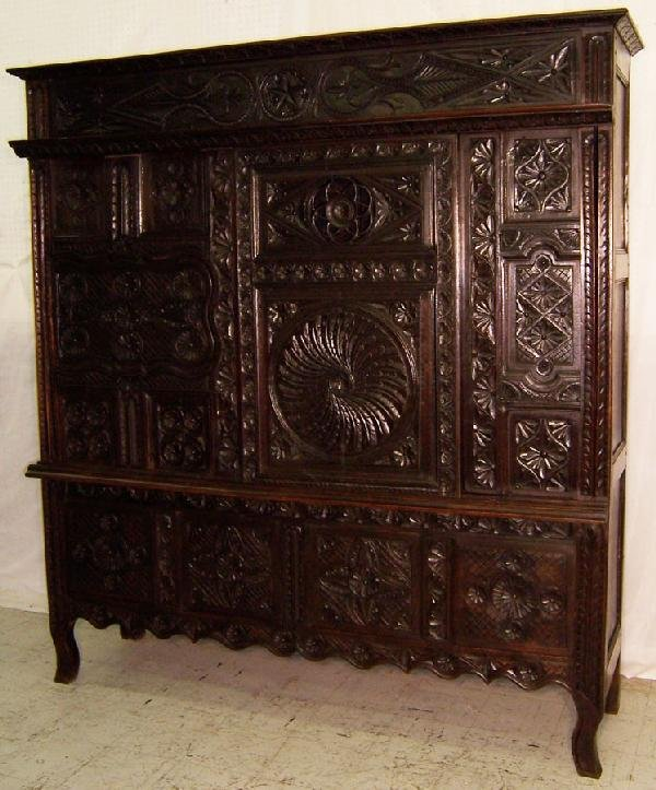 306: 18th century carved Jacobean style wall cupboard.