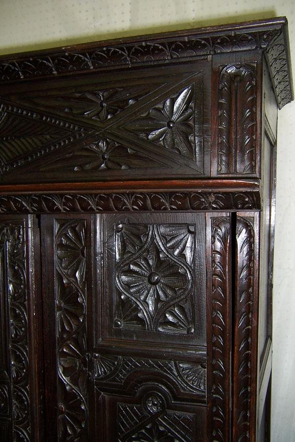 306: 18th century carved Jacobean style wall cupboard. - 2