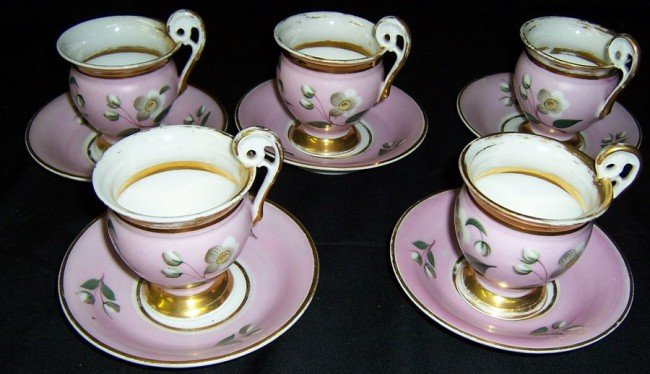 11: 5 early Old Paris cups and saucers.