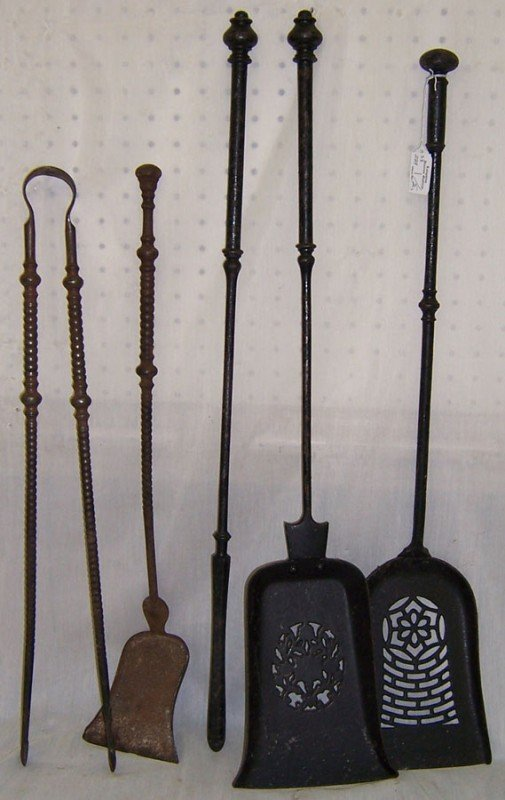 25: 5 pieces early wrought iron fireplace tools.