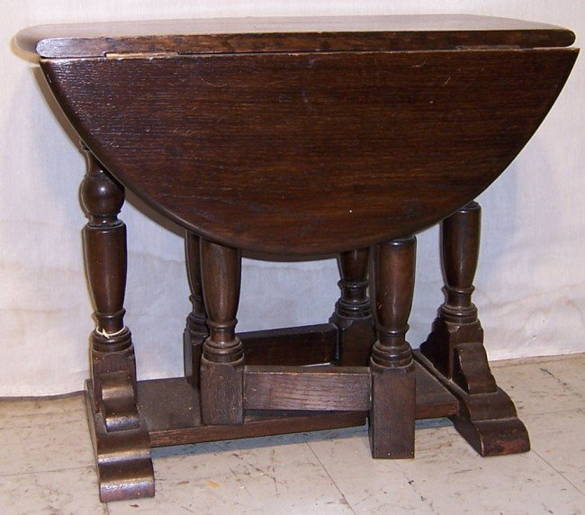 5: English oak gate leg drop leaf tea table.