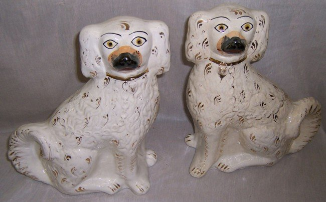 7: Pair of 19th c Staffordshire gold decorated spaniels