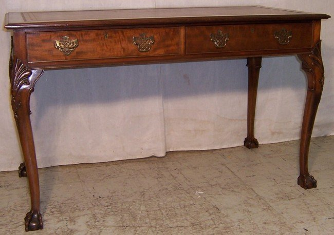 9: Mahogany ball/claw foot leather top 2 drawer table.