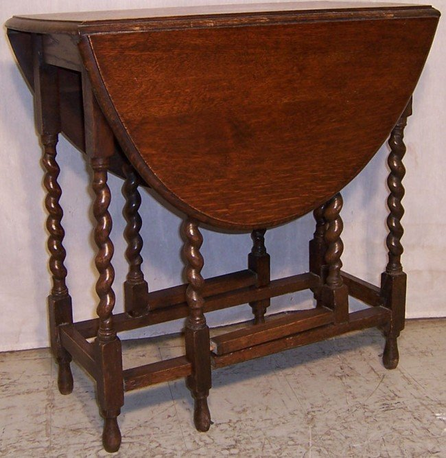 11: English oak barley twist gate leg table.