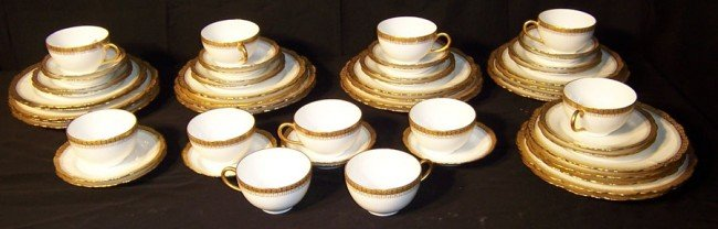 17: (57) pieces of gold decorated Limoges china.