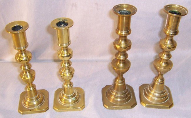 25: (2) pair of brass candlesticks