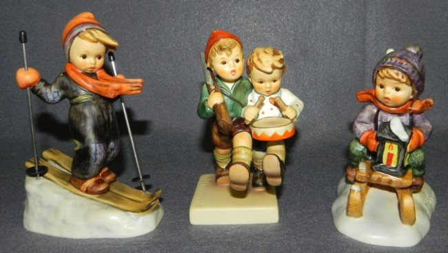 12: (3) Hummel figurines- all with original boxes.