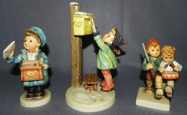 19: (3) Hummel figurines w/ original boxes.