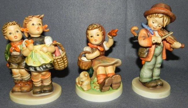 21: (3) Hummel figurines - 1 with original box.