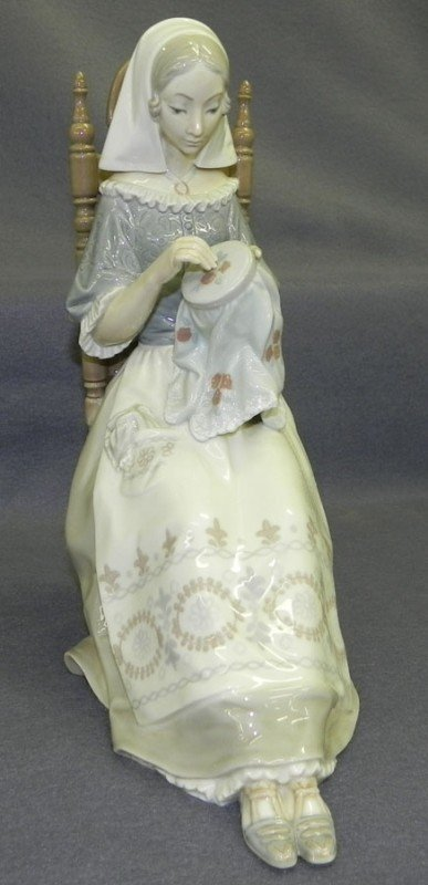 "169: Lladro ""Embroidery Lady"" figurine."