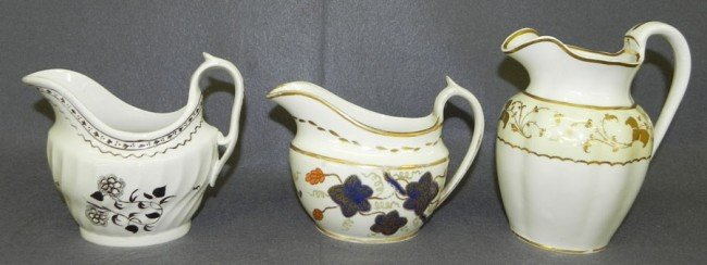 173: (3) early English cream pitchers.