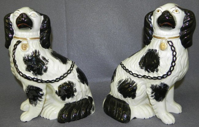 181: Pair of black and white Staffordshire spaniels.