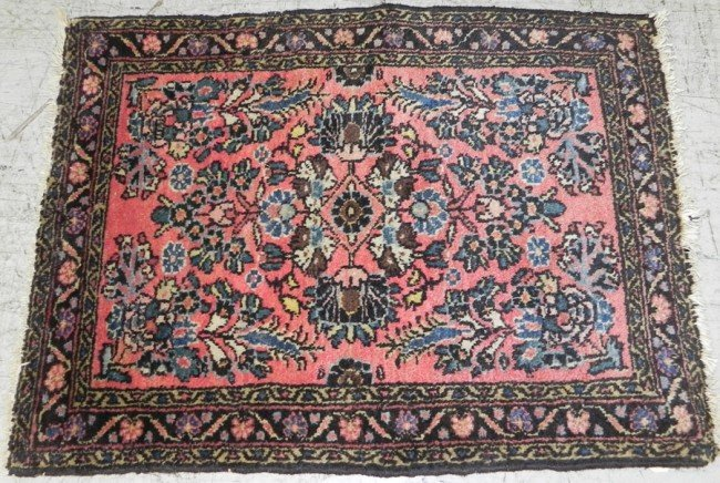 "218: 24"" x 32"" antique Persian throw rug."