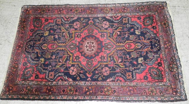 "224: 2' 7"" x 4' 2"" antique Persian rug."