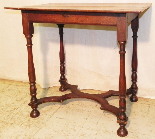 226: 18th c. English oak stretcher base center table.