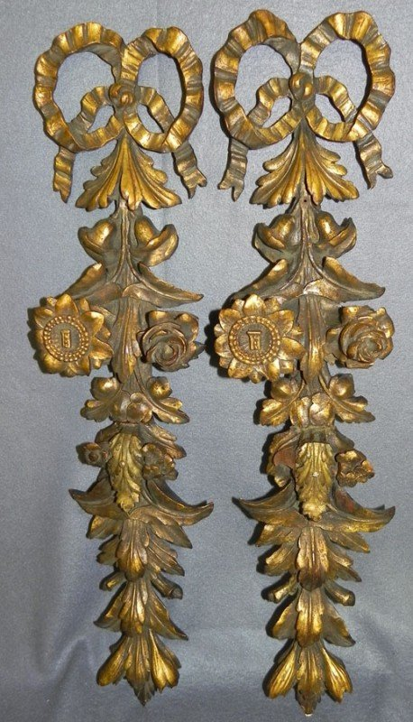 234: Pair of carved gold decorated wall hangings.