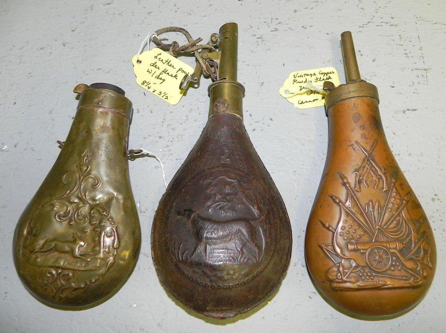 7: (2) brass powder horns & (1) leather shot pouch.