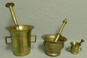 12: (3) brass mortars and pestles.