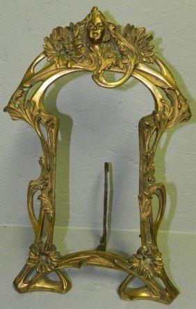 "17: Art Noveau early brass frame. 9 1/4"" x 16""."