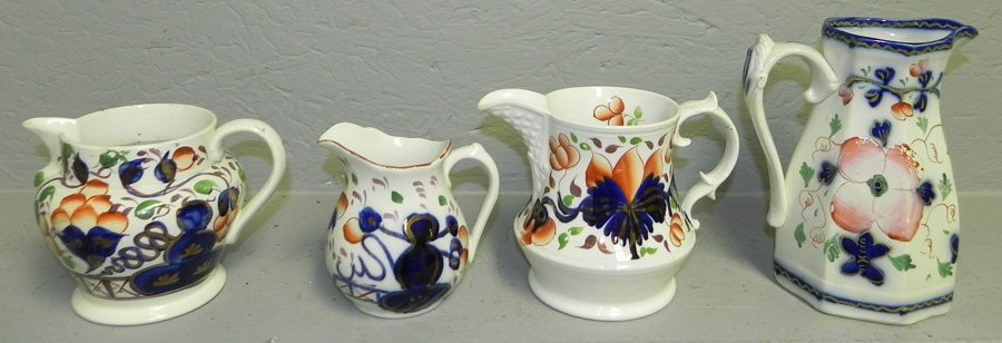 22: (4) early decorated pitchers.