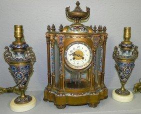 129: Tiffany & Co. cloisonné & enamel clock w/ lamps.