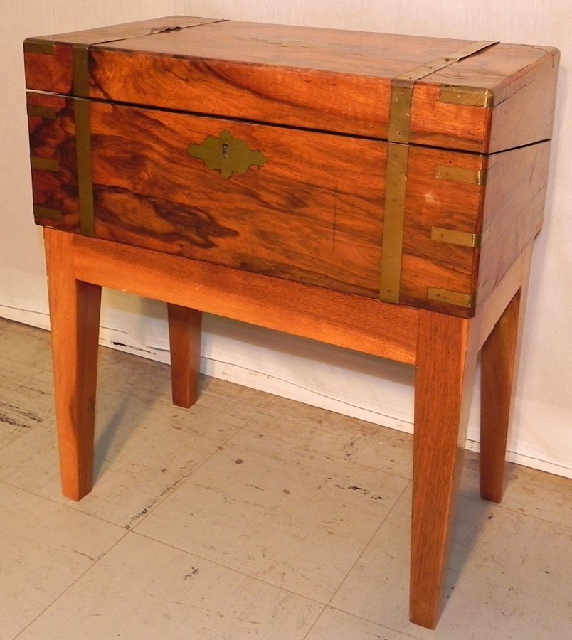 138: Rosewood brass bound lap desk on stand.
