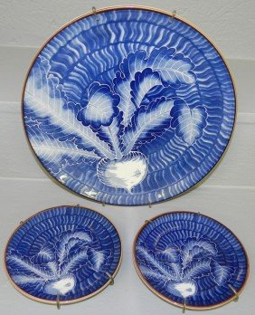 16: 2 small ceramic plates, 1 charger (turnip pattern)