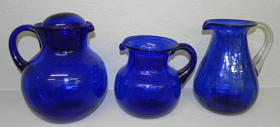 22: (3) Hand blown cobalt pitchers