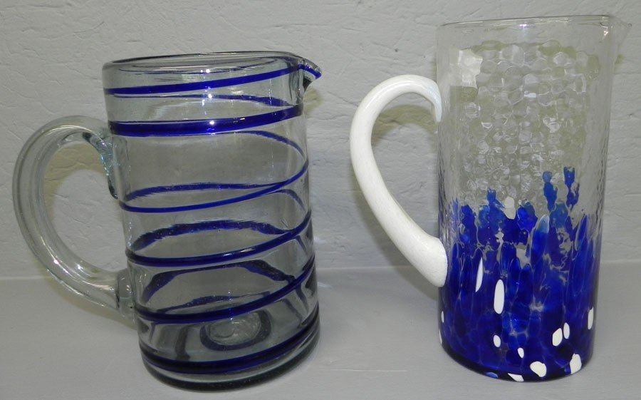 23: (2) Art glass pitchers