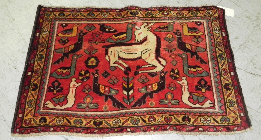 "23: 2'1"" x 3'4"" Antique Persian rug with animals."