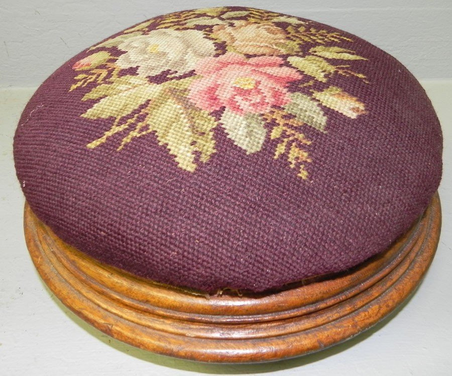 28: Round needlepoint walnut Victorian stool.
