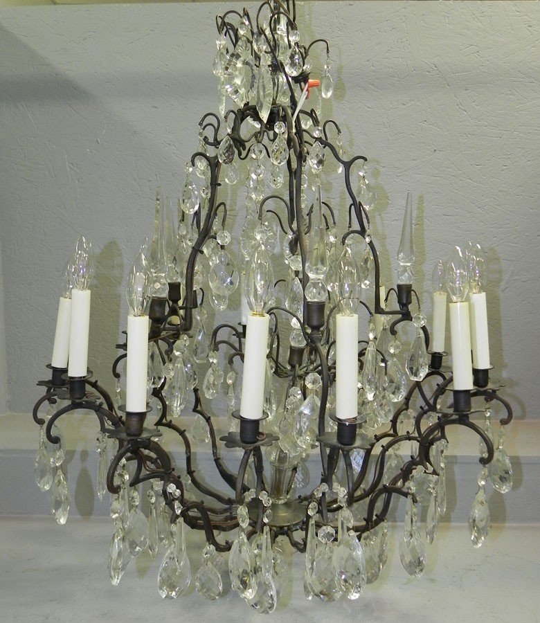 47A: Bronze and crystal 16 light chandelier.