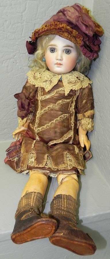 53: Bisque head and jointed wooden body doll