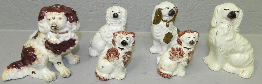 109: (6)misc. Staffordshire miniature dog figurines.